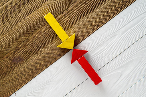 istock Two arrows pointing to each other. 831601742