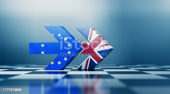 Two arrows textured with British and European Union flags pointing the same direction on black and white chessboard. Politics and strategic partnership concept. Horizontal composition with selective focus and copy space.