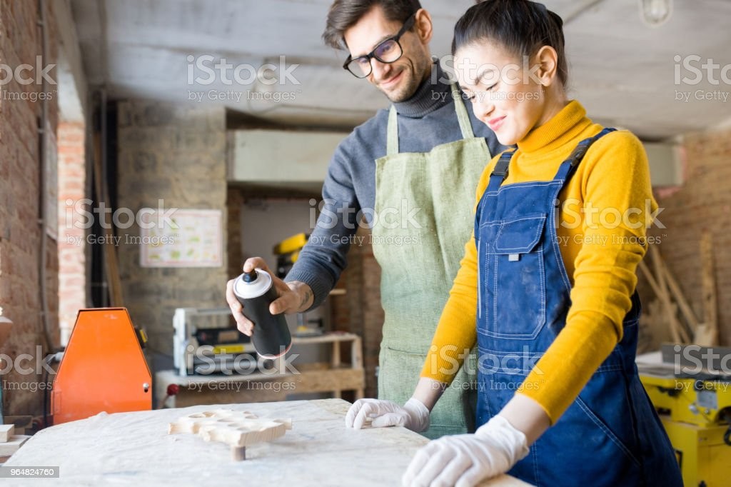 Two artists Doing Creative Woodwork royalty-free stock photo