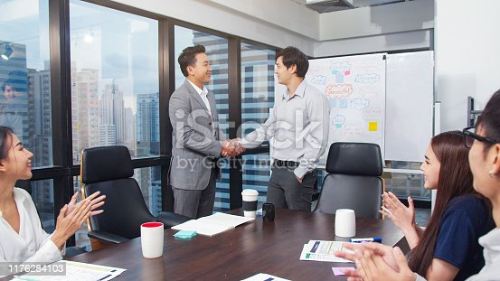 541976840 istock photo Two Asian business man shaking hands during a meeting in the office.dealing greeting and partner concept.group of business team successful 1176284103