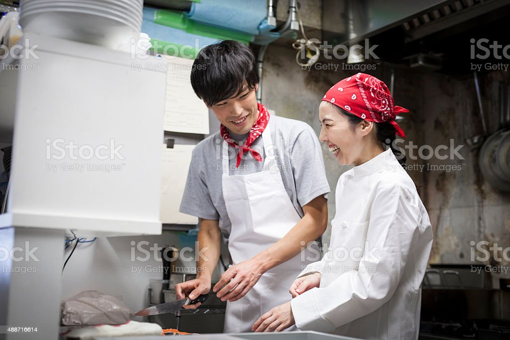 Two Asian Chefs Cooking Together stock photo
