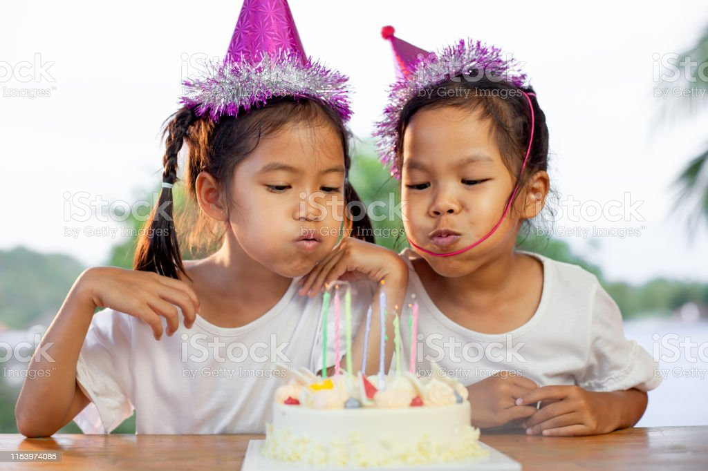 Magnificent Two Asian Child Girls Celebrating Birthday And Blowing Candles On Funny Birthday Cards Online Inifofree Goldxyz