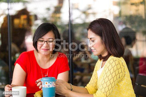 istock Two Asian Female Friends Hang Out at Outdoor Cafe 494558502