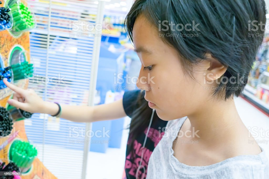 two Asian girls back to school shopping stock photo