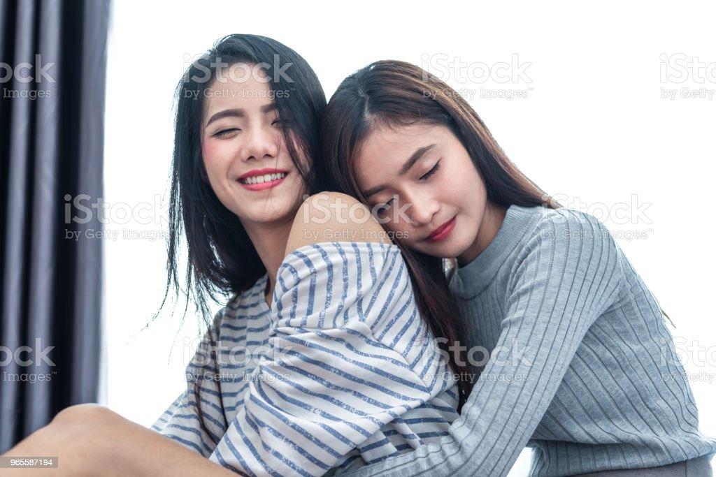 Asian lesbians making love