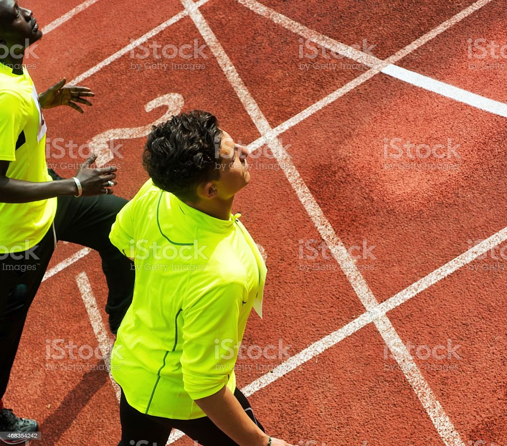 Two Athlets Crossing the Finish Line royalty-free stock photo