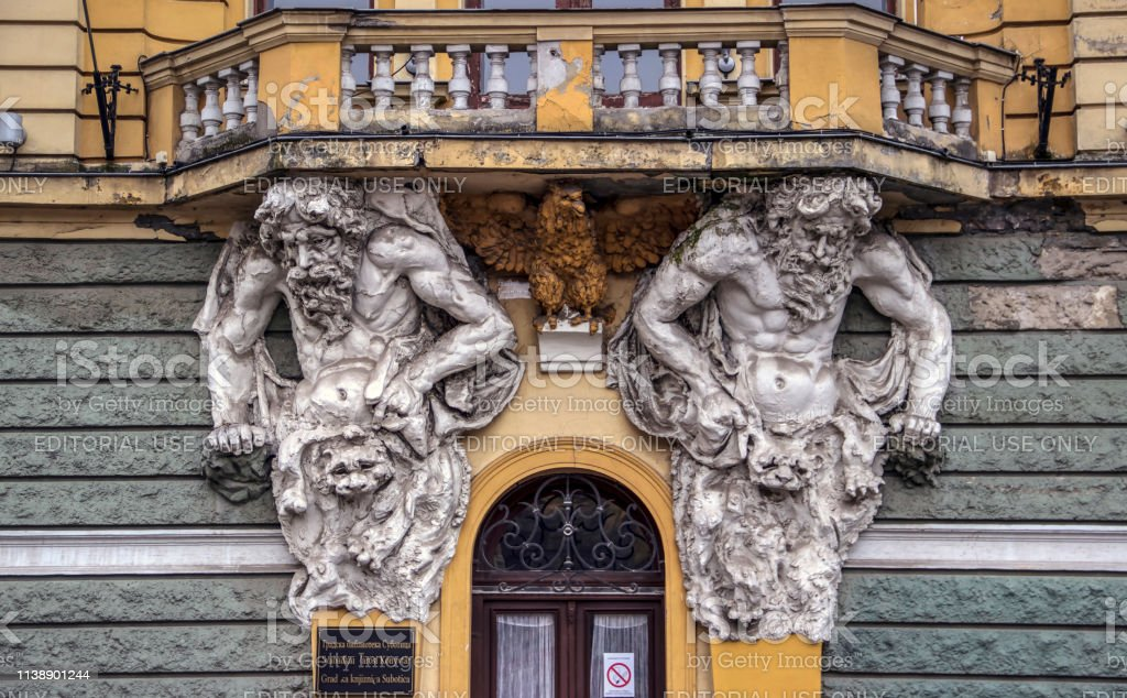 Two Atlas Figures Supporting The Balcony Stock Photo & More Pictures of  Aging Process