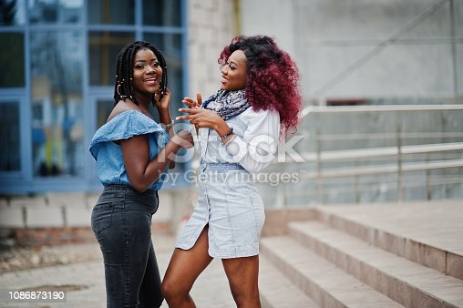 istock Two attractive african american womans 1086873190