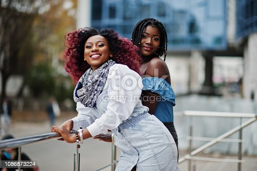 istock Two attractive african american womans 1086873224