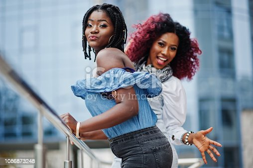 istock Two attractive african american womans 1086873248