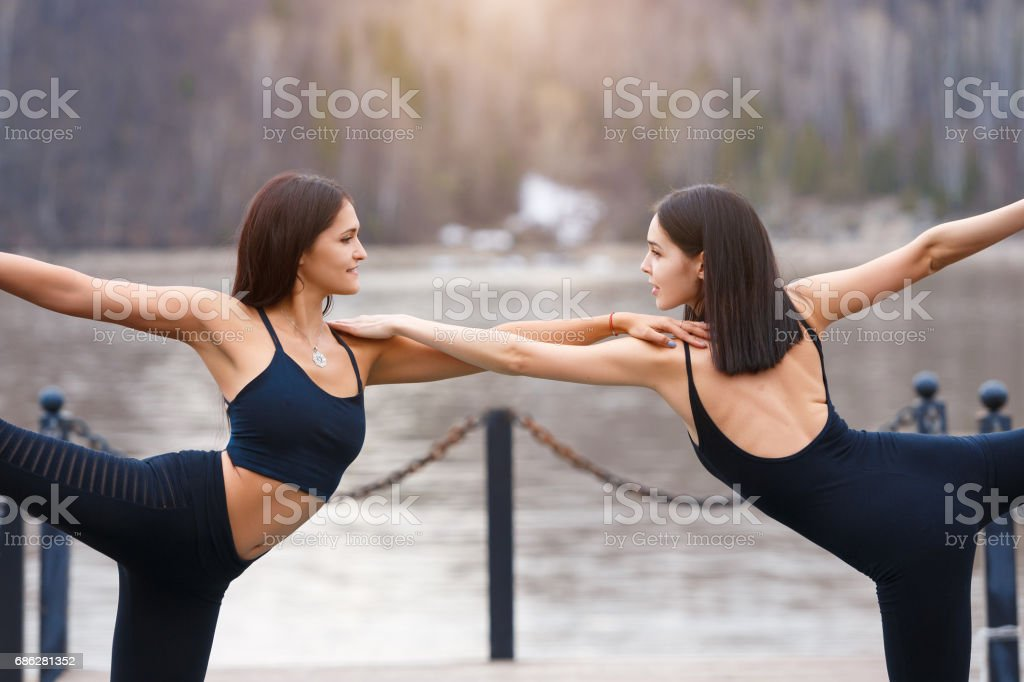 Two attractive indian sport girls work out yoga asana lord of the...