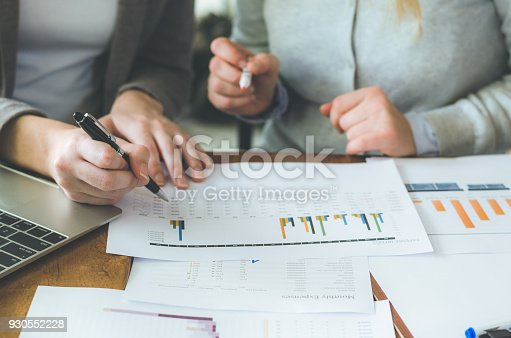 istock two attractive business woman teamwork working on table with strategy and analyze from document for decision in planning new project. 930552228