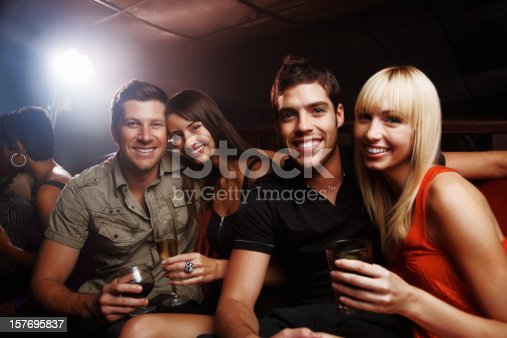 istock Two attractive couples with drinks having fun at night party 157695837