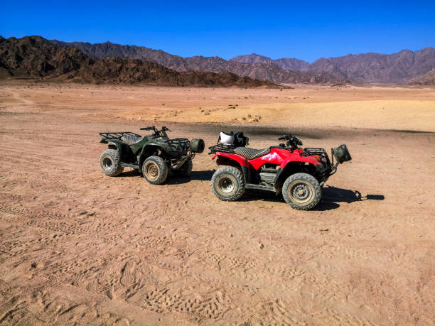 Two ATVs against the backdrop of mountains in the South Sinai Desert near Sharm El Sheikh (Egypt) stock photo