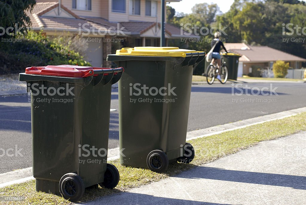 Two Australian rubbish bins Red is rubbish, yellow is recycling stock photo