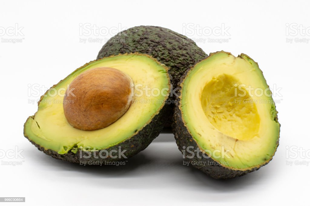 two avocados, isolated on white background stock photo