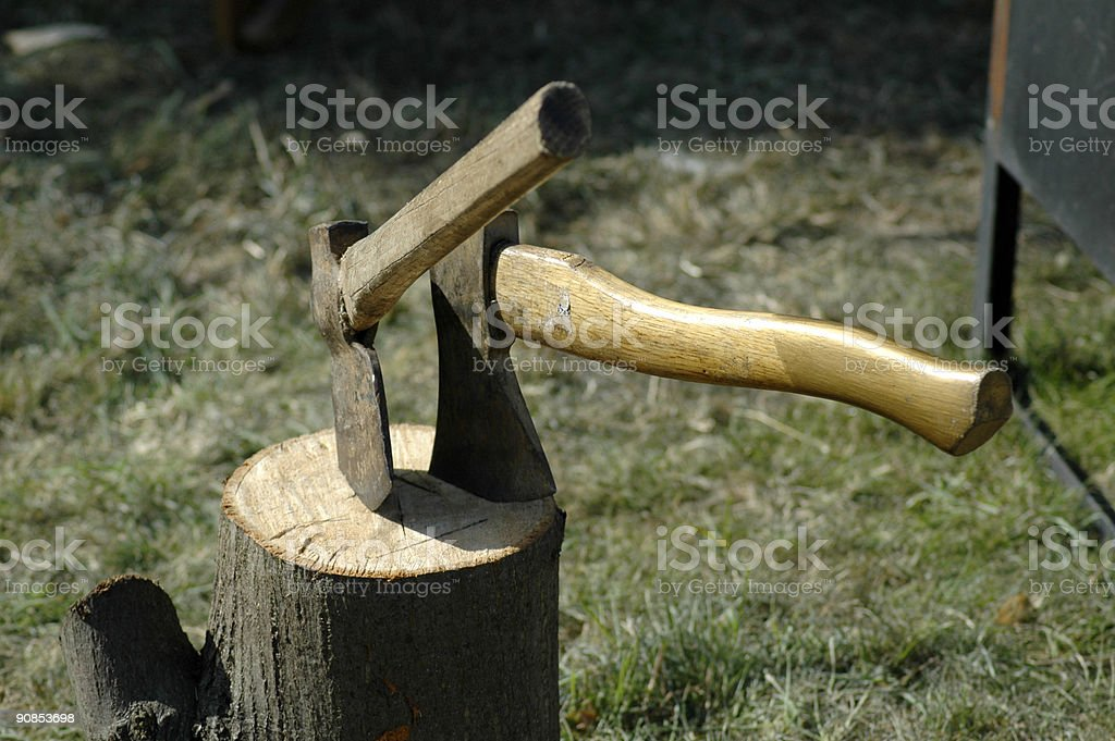 Two axes in stump stock photo