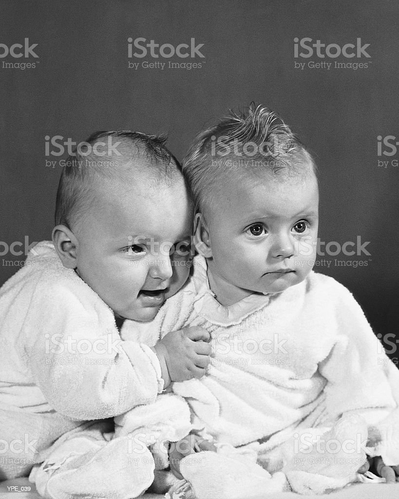 Two babies in pajamas royalty-free stock photo