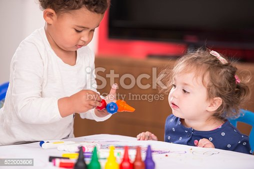 istock Two baby girls drawing. 522003606