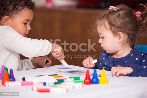 istock Two baby girls drawing. 522005142