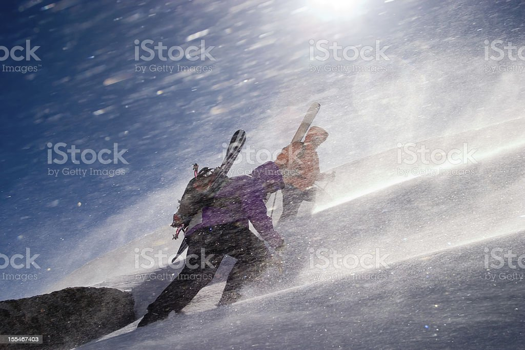 Two back country riders breaking a trail upwards stock photo