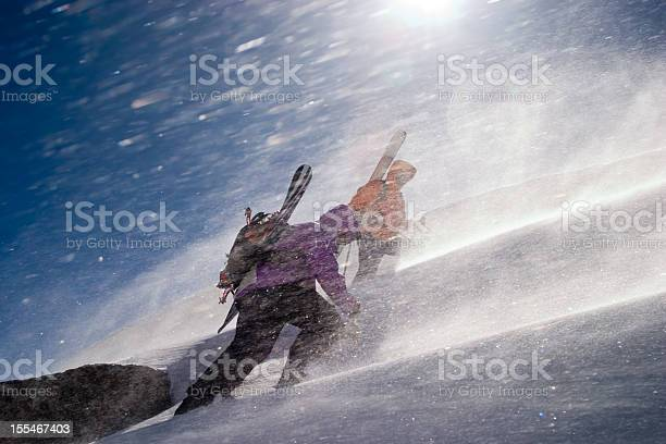 Photo of Two back country riders breaking a trail upwards