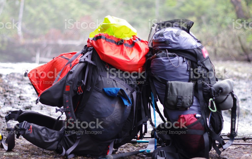 Two backpacks resting against one another stock photo
