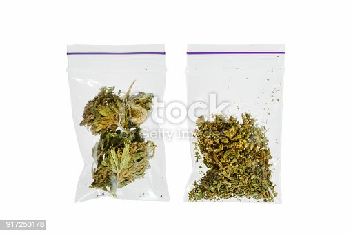 istock Two bags of different marijuana on a white background 917250178