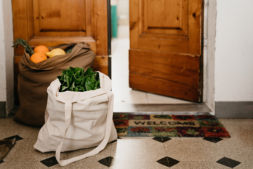 Two bags of fruit and vegetables delivered near the home door