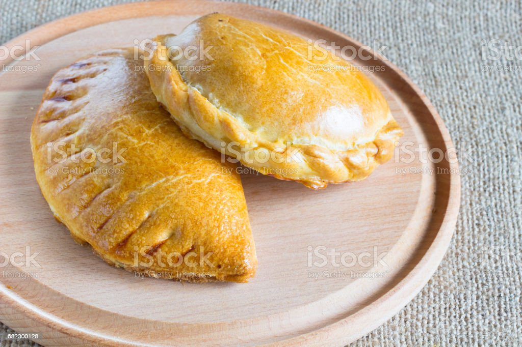 Two baked stuffed buns on the  cutting board stock photo