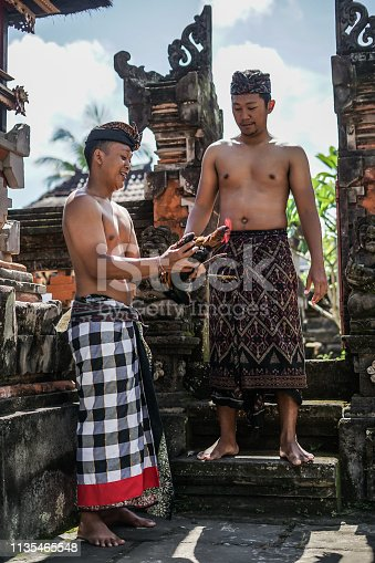 Two Balinese Man with Chicken