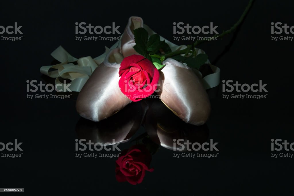 Two ballet slippers and red rose on shiny black surface with two ballet slippers and red rose on shiny black surface with spotlight effect royalty free mightylinksfo