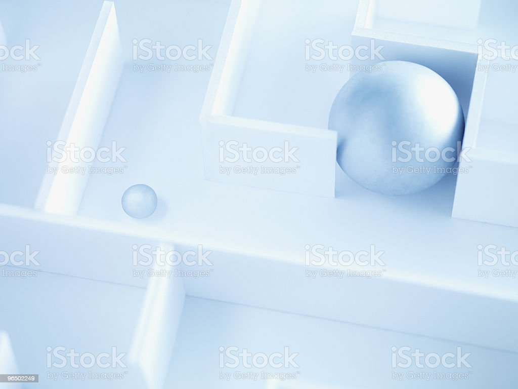 Two balls in maze stock photo