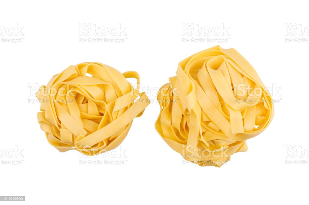 two balls of tagliatelle pasta isolated on white stock photo