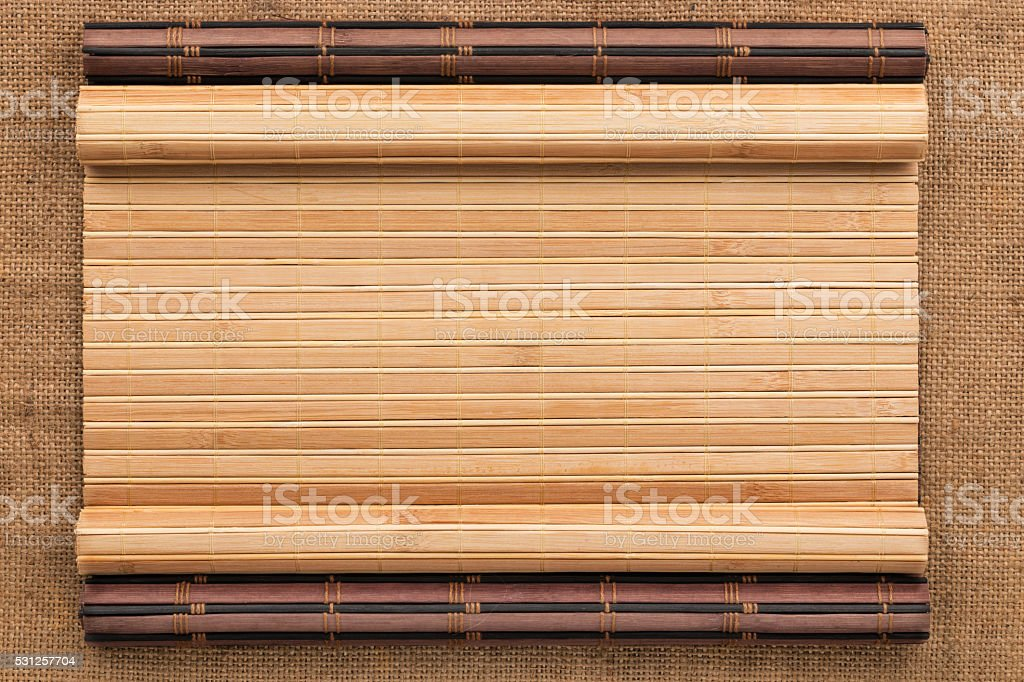 Two bamboo mat twisted in the form of a manuscript stock photo