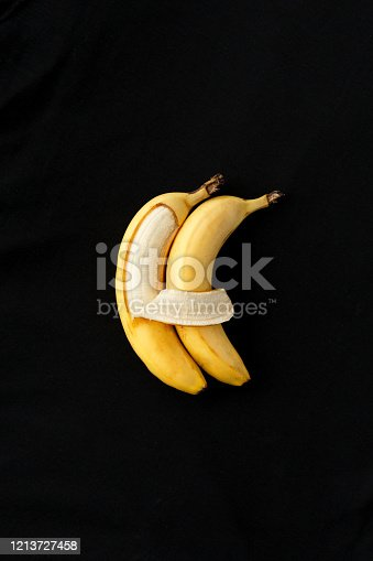 857345082 istock photo Two bananas lie side by side and hug each other like people. 1213727458
