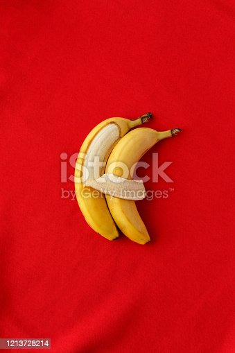 857345082 istock photo Two bananas lie side by side and hug each other like people. 1213728214