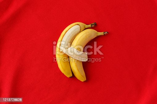 857345082 istock photo Two bananas lie side by side and hug each other like people. 1213728628