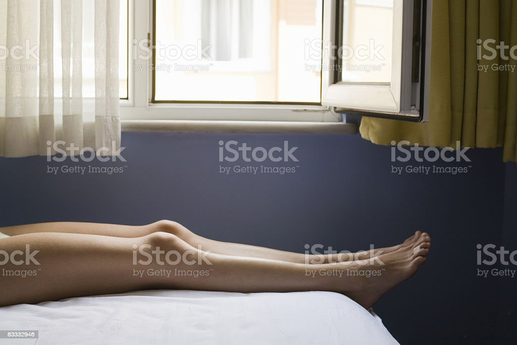Two bare legs on bed. royalty free stockfoto
