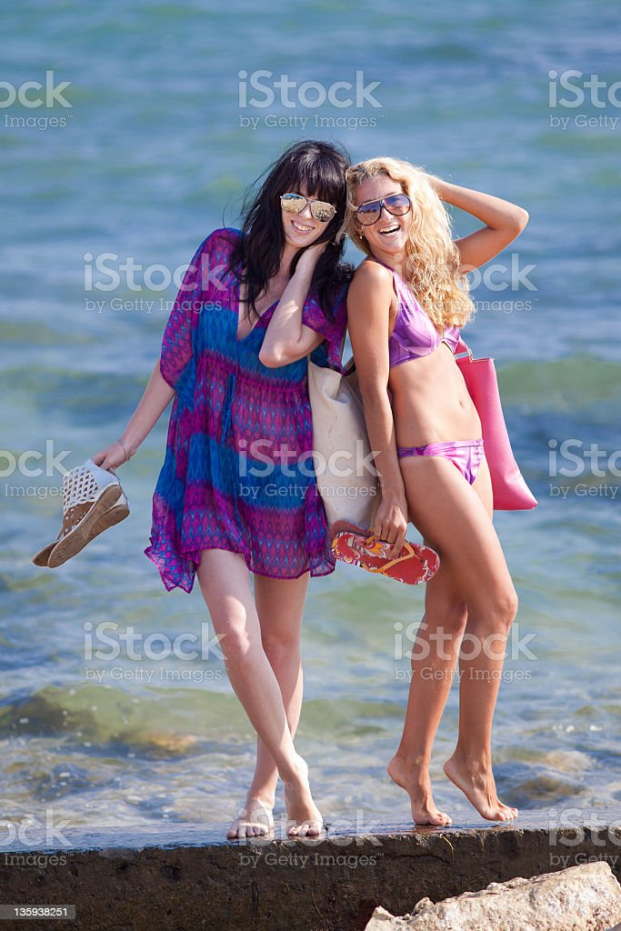 Two Barefoot Girls At The Sea Royalty Free Stock Photo