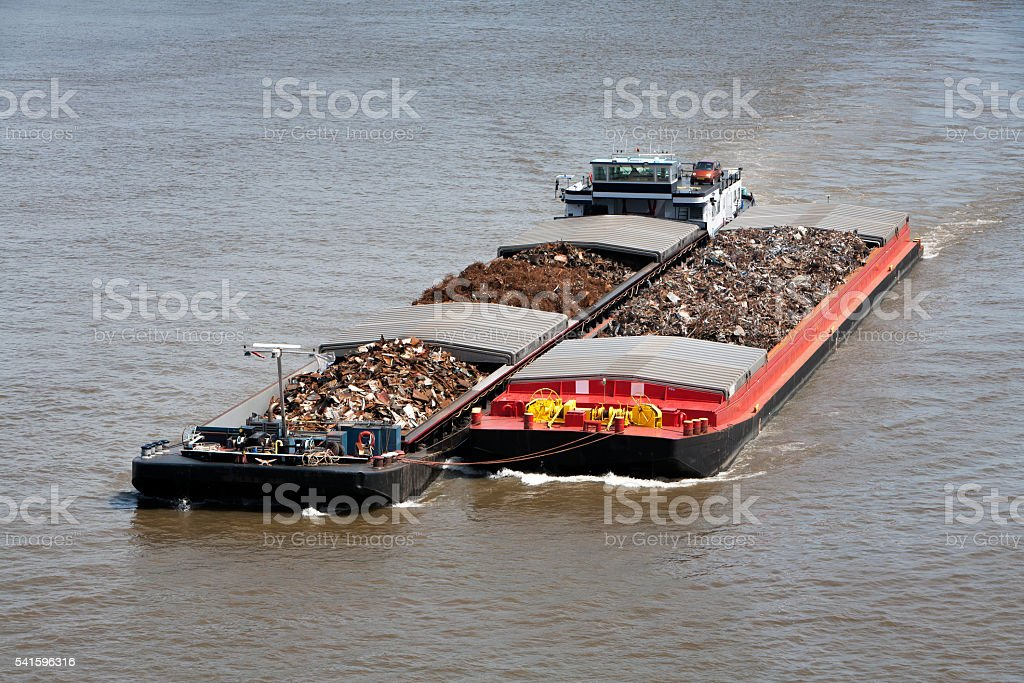 Two barges loaded with metal scrap stock photo