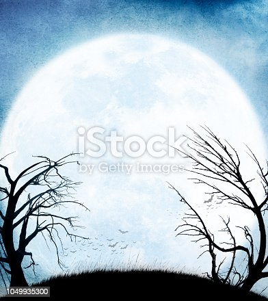 A colony of bats and two barren trees are silhouetted against a rising full moon.