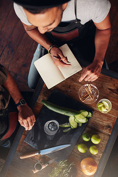 two bartenders experimenting with creating cocktails - zimt gurken stock-fotos und bilder