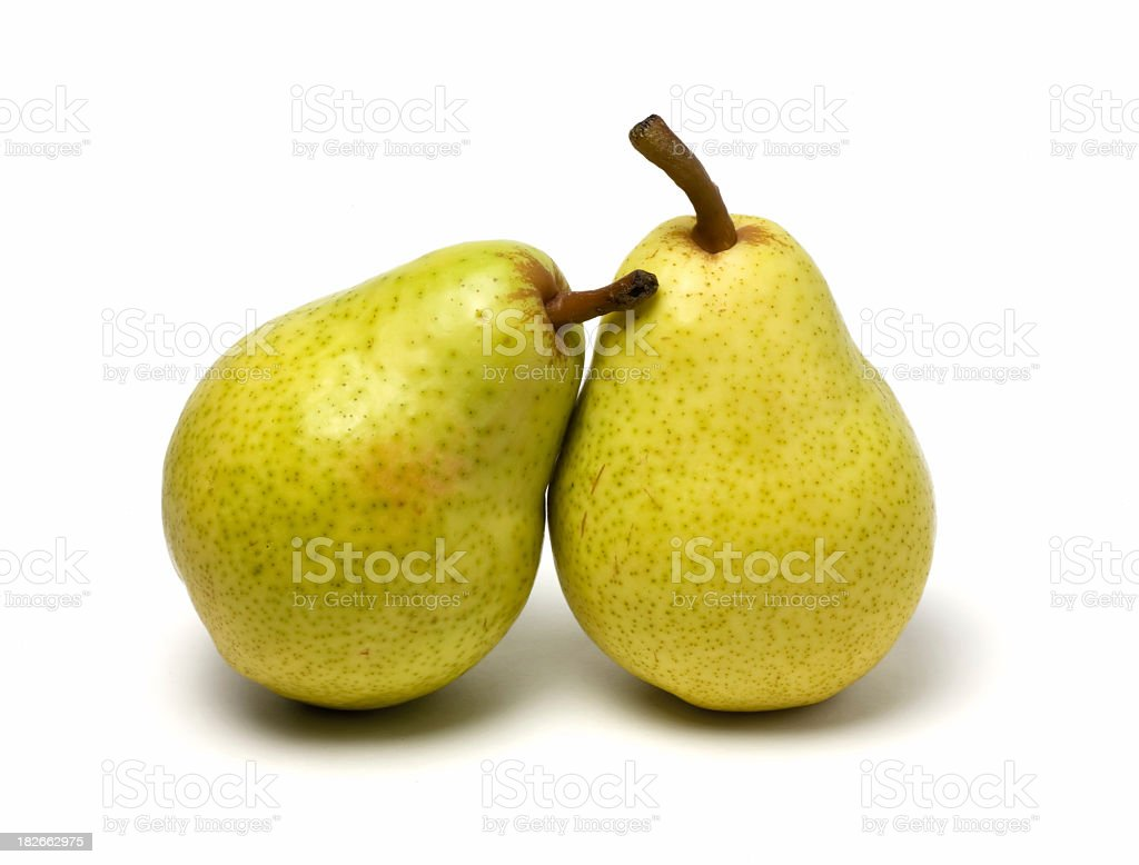 Two bartlett pears leaning on each other stock photo