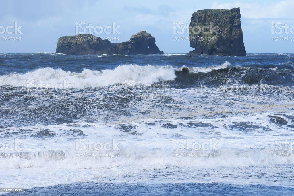 Two basalt rocks in sea stock photo