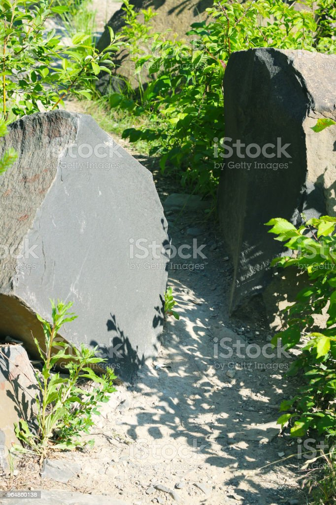 two basalt stones on trail royalty-free stock photo