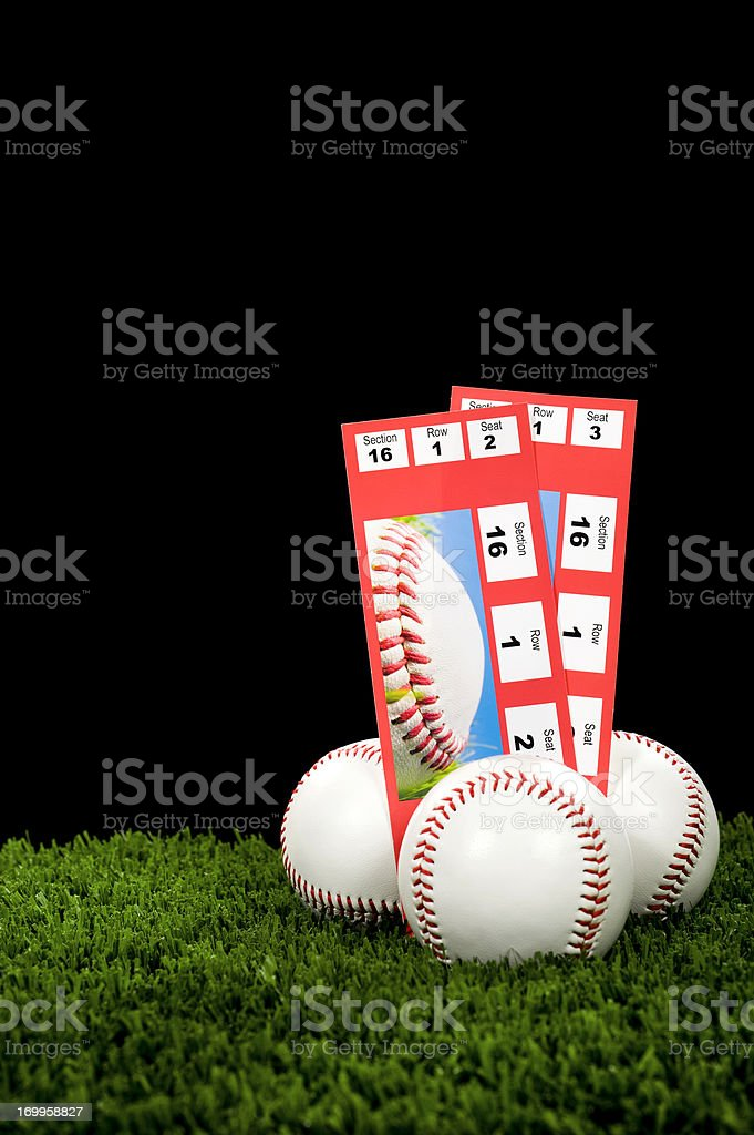 Two Baseball Tickets stubs, with new baseballs - Night Game royalty-free stock photo