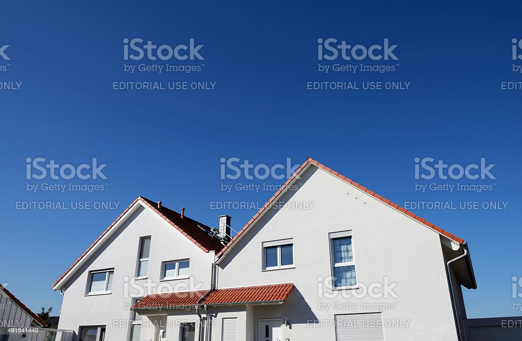 Two basic family houses and deep blue sky stock photo