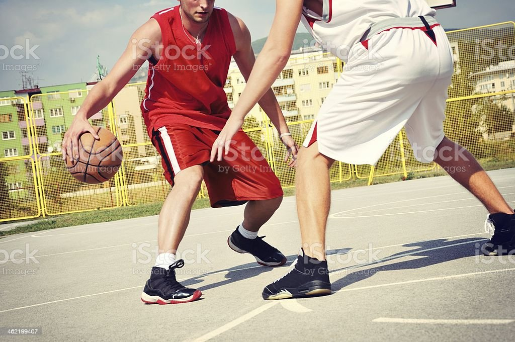 Two basketball players on the court royalty-free stock photo