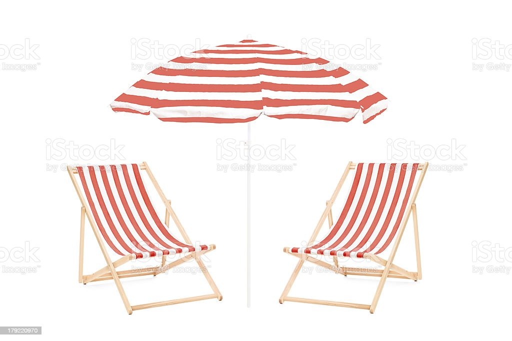 Two beach sun loungers and an umbrella stock photo